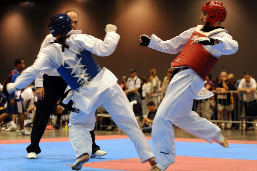 "0982-RiderKOsKing9148.jpg: U.S. Army World Class Athlete Program martial artist Sgt. William Rider delivers a knockout kick to the ribs of Californian Cory King with 1 minute, 3 seconds remaining in the second round of their featherweight semifinal match at the 2009 U.S. National Taekwondo Championships July 5 at the Austin Convention Center in Texas. ""In my 25 years of Taekwondo, I think that's the second time I've ever seen a body shot knockout, and the first from a roundhouse kick,"" WCAP Taekwondo coach David Bartlett said. ""I have to give thanks to the strength and conditioning program of Master Sgt. Mike Mielke."" Photo by Tim Hipps, FMWRC Public Affairs"