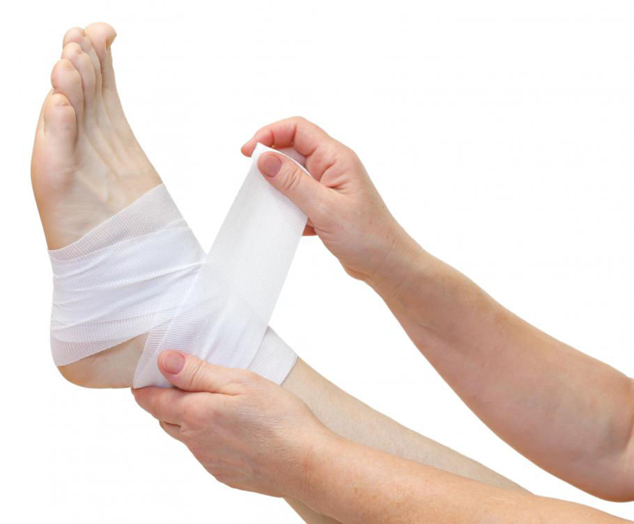 person-wrapping-bandage-around-foot